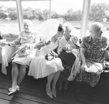 A bride chats to her aunties on a ride down the Thames © Ruth Corney